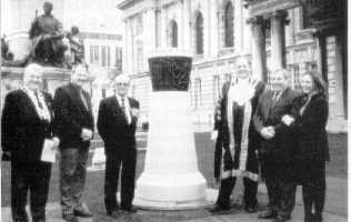 Pictured at the Magennis Memorial outside Belfast City Hall, L to R. Institute Deputy President Denis Ranaghan, Comdr. Ian Frazer, VC., The Lord Mayor of Belfast Cllr. Robert Stoker, Michael Magennis, Paul Magennis (Son) and Mary Magennis (Grand daughter) Mar. Inst. Photo: Pat Sweeney
